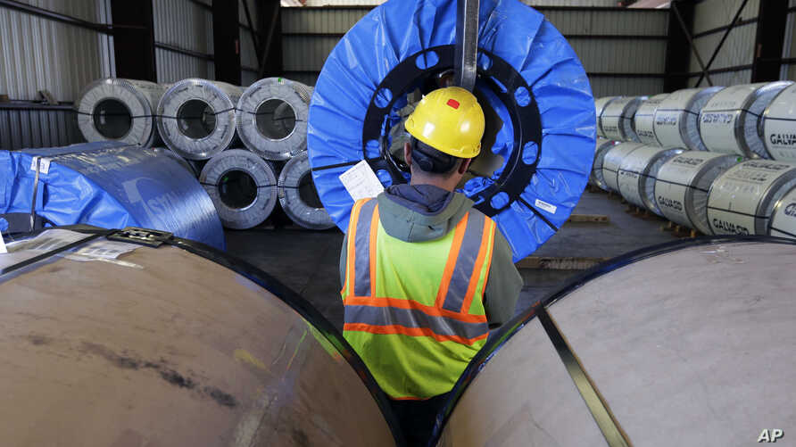 A worker uses a lift to move rolls of sheet metal at LMS International in Laredo, Texas, Nov. 21, 2016. U.S. border cities that have thrived under NAFTA, such as Laredo and El Paso in Texas and Nogales in Arizona, now worry that an economic reckoning