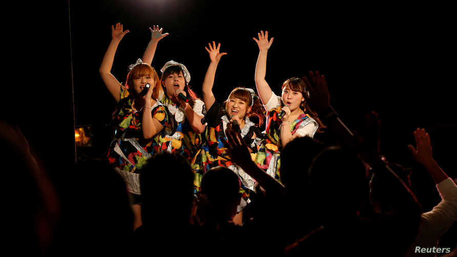 Members of pop group Pottya perform at a live theatre in Tokyo, Japan, Nov.10, 2016.