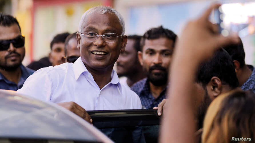 Maldivian president-elect Ibrahim Mohamed Solih arrives at an event with supporters in Male, Sept. 24, 2018.