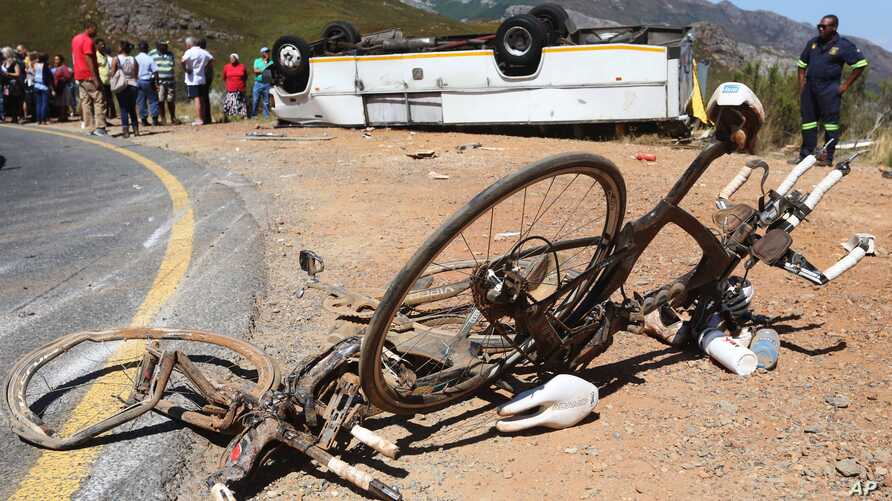 FILE - Two bikes (C) that were involve in a accident with a bus that turned on its roof near the town of Franschhoek, South Africa, March 7, 2015. The bus crashed and landed on its roof  on the Franschhoek pass on Saturday as the driver attempted to