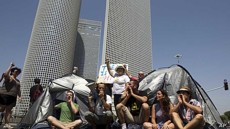 Israeli demonstrators block a main junction with tents as they protest against rising housing prices and social inequalities, Tel Aviv, Israel, July 25, 2011