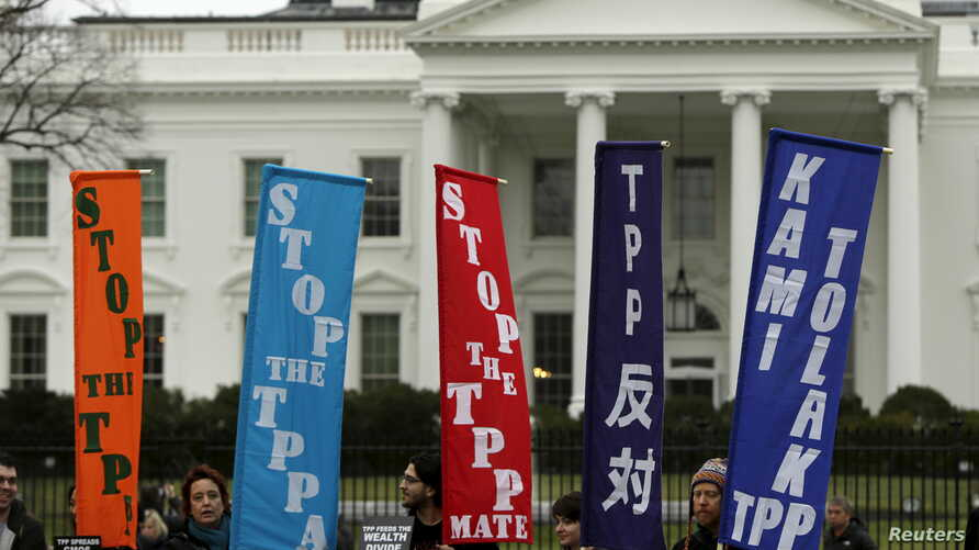 FILE - Opponents of the Trans Pacific Partnership (TPP) trade agreement protest outside of the White House in Washington, Feb. 3, 2016.