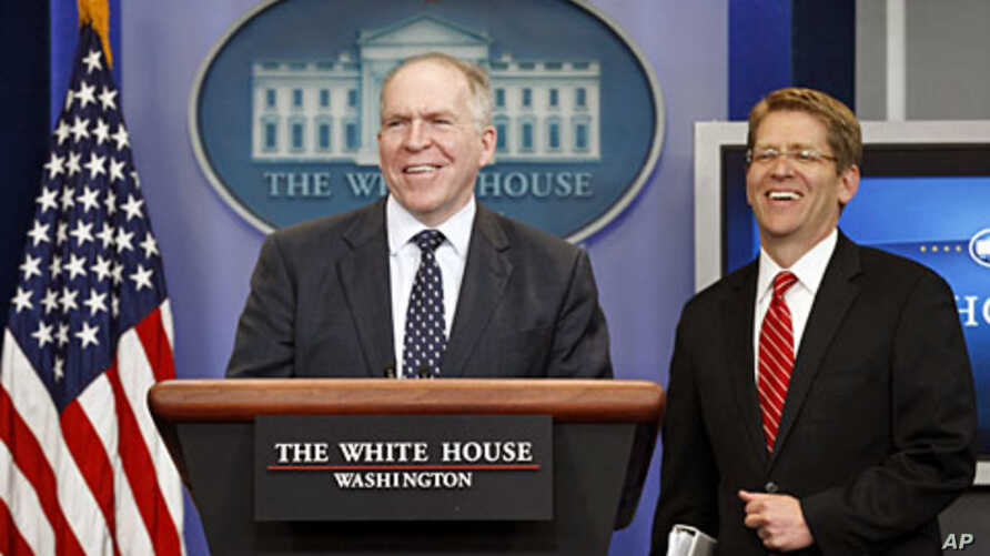 John Brennan (L), assistant to the president for homeland security and counterterrorism, and White House Press Secretary Jay Carney smile as they take the rostrum to speak about the killing of Osama bin Laden at the White House, Washington May 2, 201