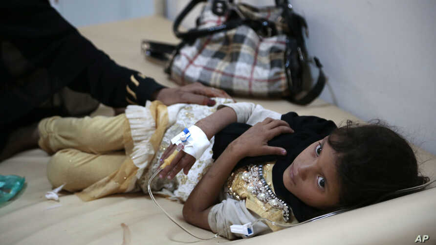 A girl is treated for suspected cholera infection at a hospital in Sanaa, Yemen, Saturday, Jul. 1, 2017.