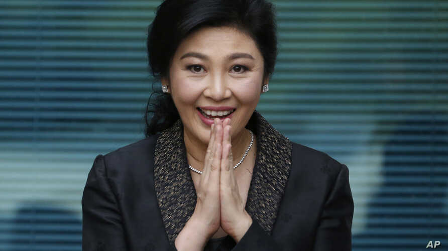FILE - Thailand's former Prime Minister Yingluck Shinawatra arrives at the Supreme Court to make her final statements at her trial in Bangkok, Thailand, Aug. 1, 2017. She was convicted, sentenced in absentia, and is believed to be in Dubai.