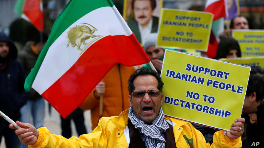 An opponent of Iranian President Hassan Rouhani chants slogans during a protest outside the European Union Council in Brussels, Belgium, Jan. 3, 2018.
