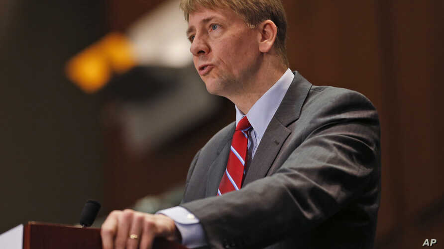 """FILE - Consumer Financial Protection Bureau Director Richard Cordray, pictured in March 2015, says arbitration clauses in consumers' agreements with financial companies effectively deny groups """"the right to seek justice and relief for wrongdoing."""""""