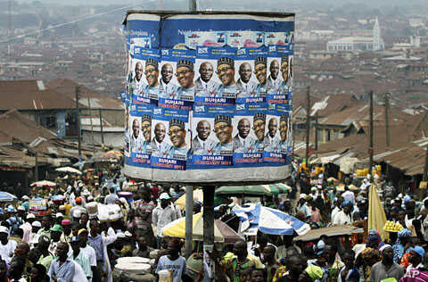 An advertisement tank is plastered with posters of former military ruler Muhammadu Buhari and his running mate Tunde Bakare during the Congress for Progressive Change (CPC) presidential campaign rally at Mapo square, Ibadan, south-west Nigeria,  Mar