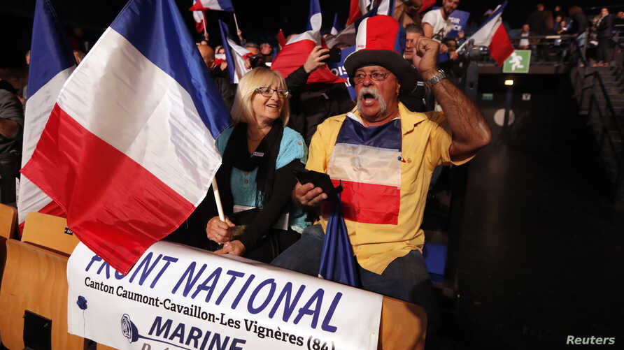 Supporters for Marine Le Pen, French National Front (FN) political party leader and candidate for French 2017 presidential election, attend a campaign rally in Nice, France, April 27, 2017.