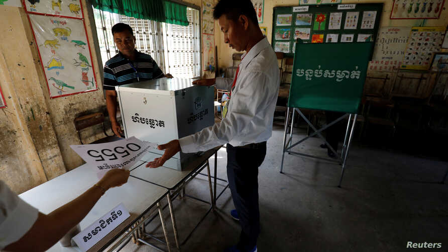 Election workers assemble a polling booth inside a classroom at a school in Phnom Penh, Cambodia, July 28, 2018.