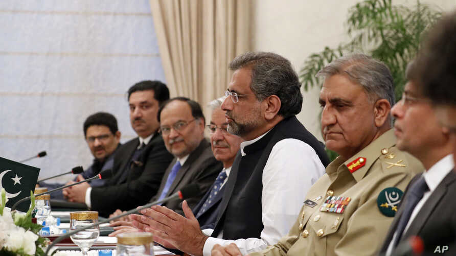 FILE - Pakistani Prime Minister Shahid Khan Abbasi, third right, speaks during a meeting at the Prime Minister's residence, Tuesday, Oct. 24, 2017, in Islamabad, Pakistan.
