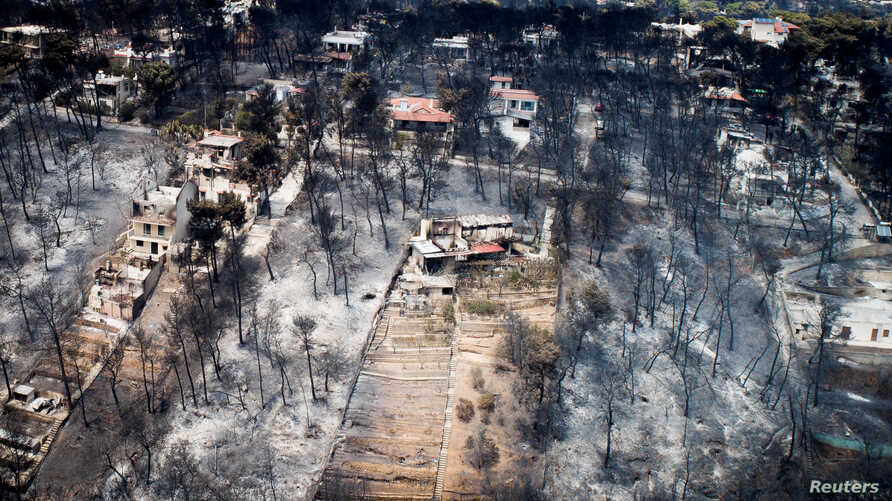 An aerial view shows burnt houses and trees following a wildfire in the village of Mati, near Athens, Greece, July 25, 2018.