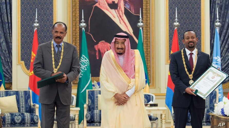 In this photograph released by the state-run Saudi Press Agency, Saudi King Salman, center, receives Eritrean President Isaias Afwerki, left, and Ethiopian Prime Minister Abiy Ahmed, right, in Jiddah, Saudi Arabia on Sept. 16, 2018.