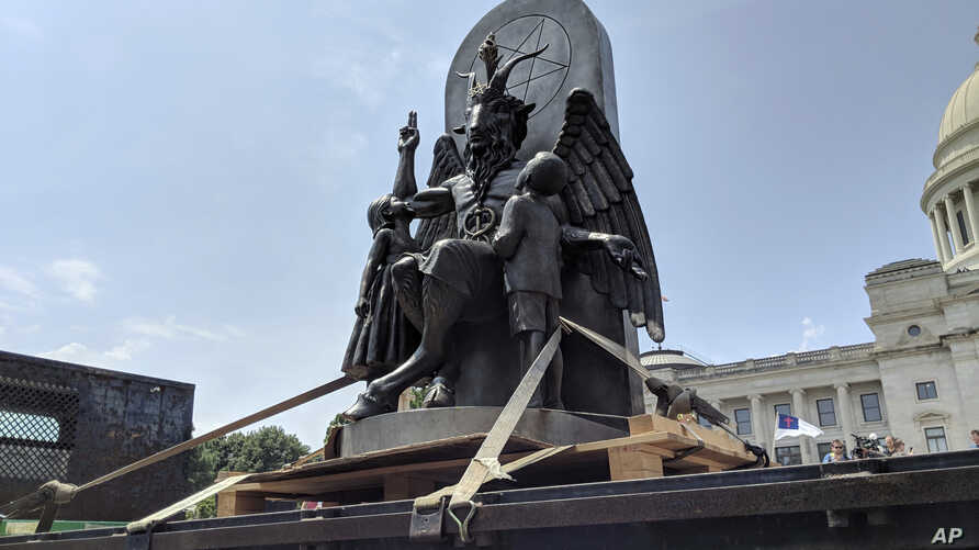 The Satanic Temple unveils its statue of Baphomet, a winged-goat creature, at a rally for the First Amendment in Little Rock, Ark., Aug. 16, 2018.