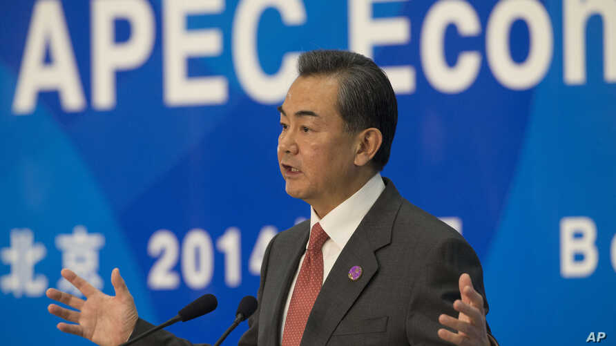 Chinese Foreign Minister Wang Yi gestures during a press conference on the Asia-Pacific Economic Cooperation (APEC) related meetings at the China National Convention Center in Beijing, China, Saturday, Nov. 8, 2014.