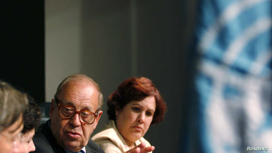 FILE- Jean Ziegler (2nd R), UN Special Rapporteur on the Right to Food, speaks with a translator during a news conference in Havana Nov. 6, 2007.