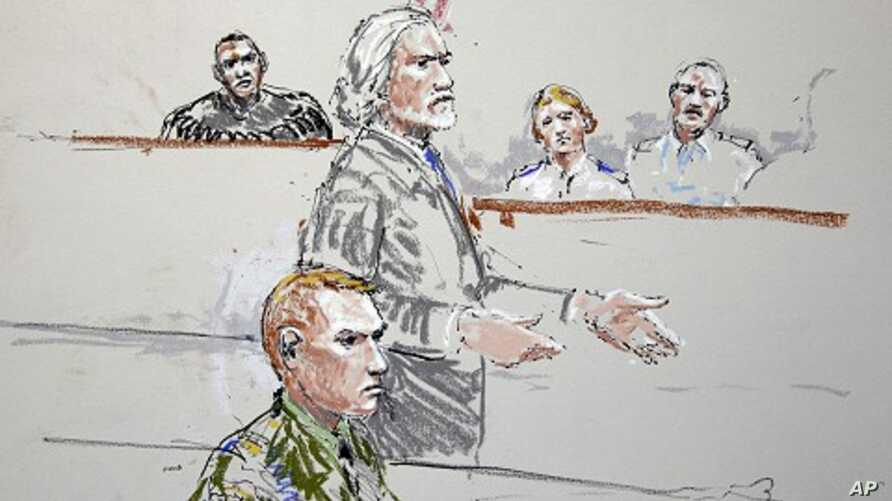 U.S. Army Staff Sgt. Calvin Gibbs, seated at lower left, is shown in this courtroom sketch as his attorney Phil Stackhouse stands at center, and military Judge Lt. Col. Kwasi Hawks listens, at top left, October 31, 2011, at Joint Base Lewis-McChord i