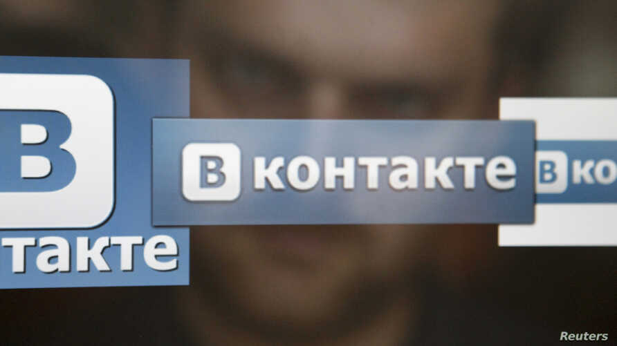 A man looks at a computer screen showing logos of Russian social network VKontakte in an office in Moscow, May 24, 2013.