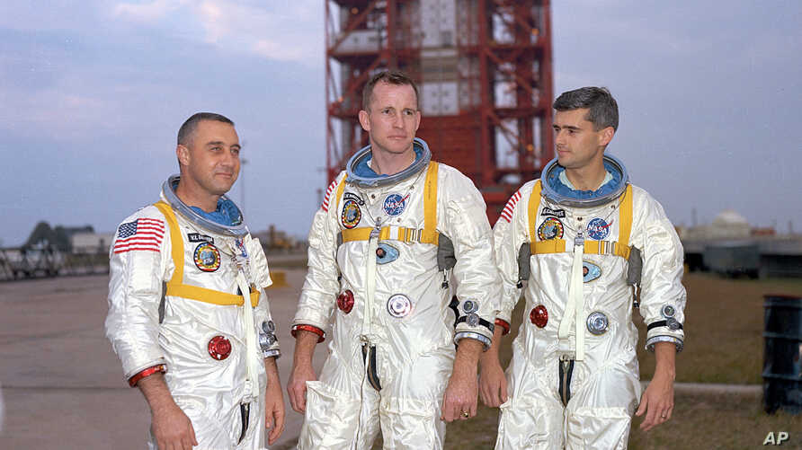 In this undated photo made available by NASA,  (L-R) veteran astronaut Virgil Grissom, first American spacewalker Ed White and rookie Roger Chaffee, stand for a photograph in Cape Kennedy, Fla.