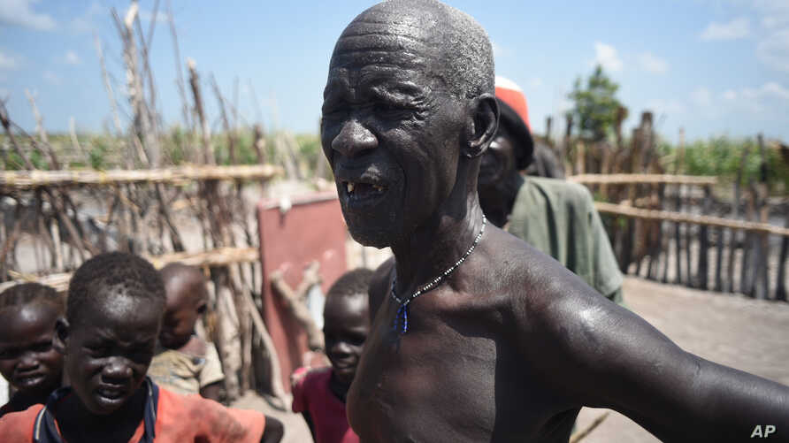 James Gatmai Yoah, in Dablual, South Sudan, has been living on leaves to survive. His home was burned in fighting between South Sudanese government troop and rebel forces.