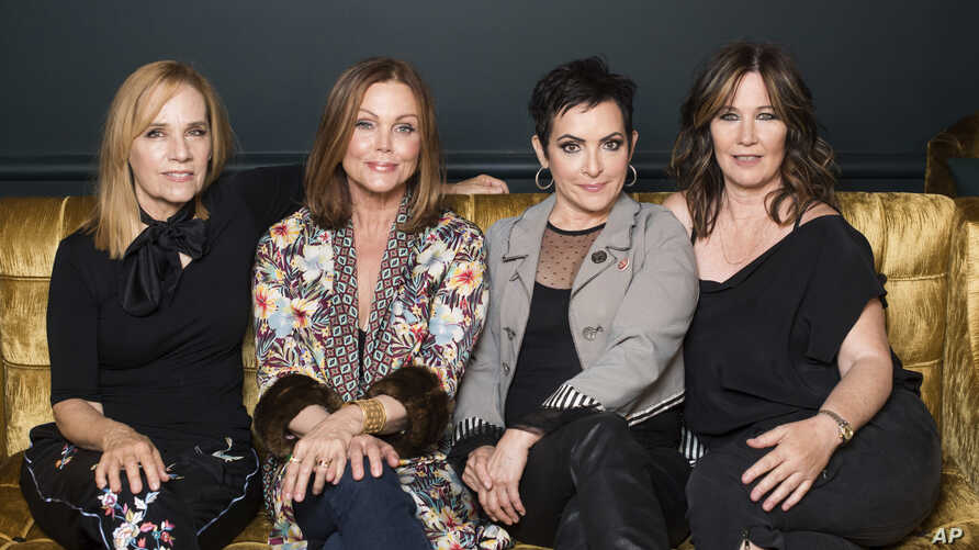 """FILE - The Go-Go's band members, from left, Charlotte Caffey, Belinda Carlisle, Jane Wiedlin and Kathy Valentine pose together during previews for the new Broadway musical """"Head Over Heels"""" in New York, July 12, 2018."""