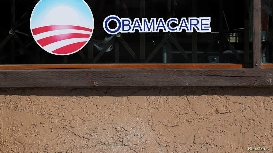 FILE - A sign on an insurance store advertises Obamacare in the San Ysidro district of San Diego,Calif., Oct. 26, 2017.