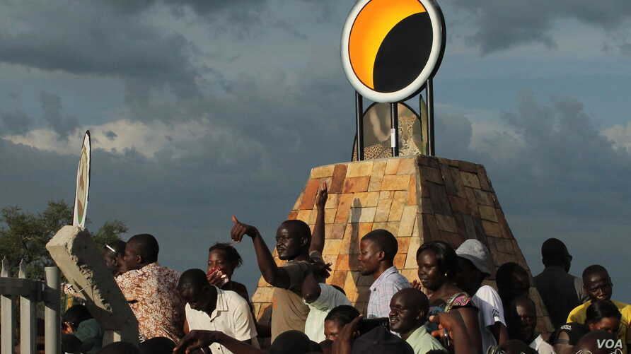 An eclipse monument was built just outside the village to commemorate the solar eclipse, in Pakwach, Uganda, Nov. 3, 2013. (H. Heuler/VOA News))