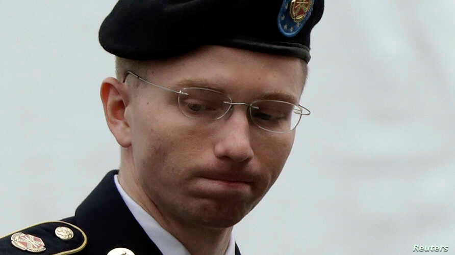U.S. Army Private First Class Bradley Manning enters the courtroom for day four of his court martial at Fort Meade, Maryland, June 10, 2013.