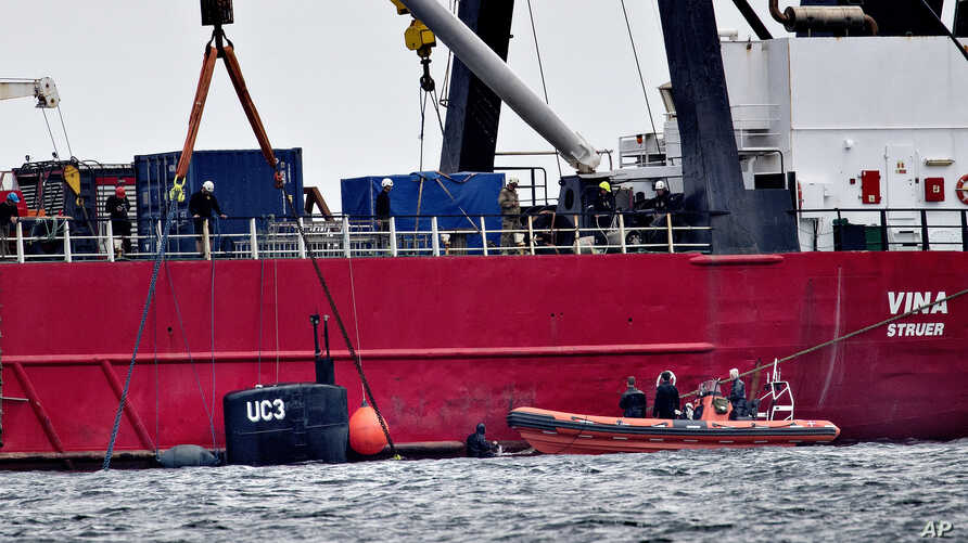 The turret of sunken privately built and owned submarine submarine UC3 Nautilus is seen by the side of a salvage vessel during an operation taking place in connection with a criminal investigation, in Oeresund strait near Copenhagen, Denmark, Saturda