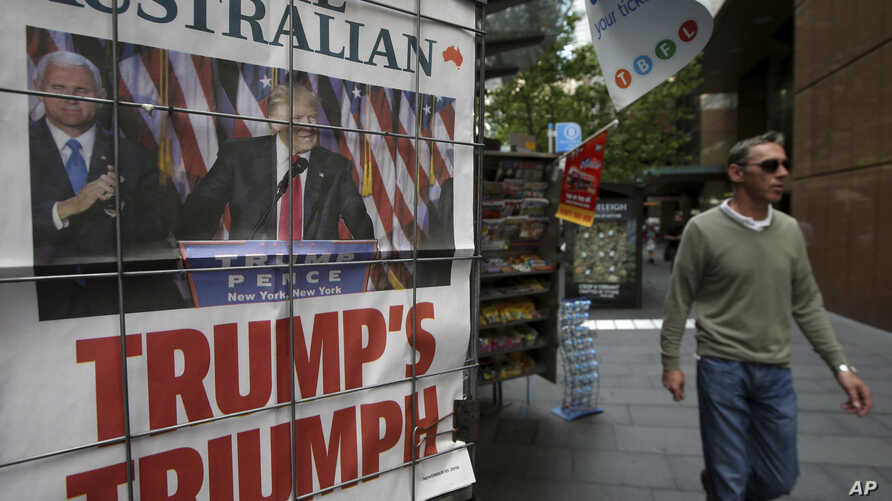 A man walks past a newspaper placard showing U.S. President-elect Donald Trump, in Sydney, Australia, Nov. 10, 2016. Reacting to Trump's election victory, Australian Prime Minister Malcolm Turnbull said that the relationship between the two countries