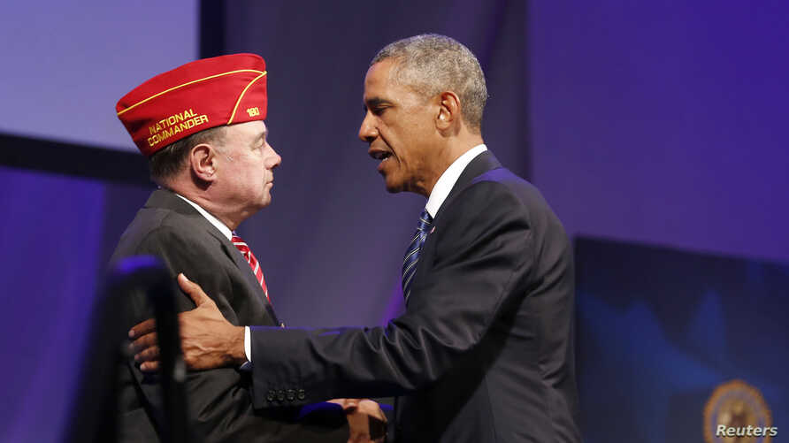 President Barack Obama shakes hands with National Commander Daniel M. Dellinger at the American Legion's 96th National Convention, Charlotte, North Carolina, Aug. 26, 2014.