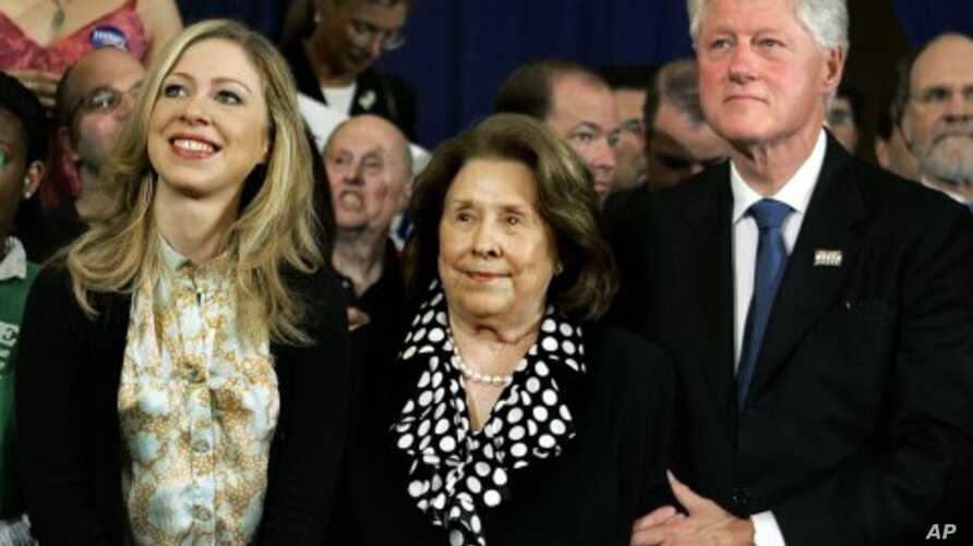 Former President Bill Clinton and his daughter, Chelsea, flank Dorothy Rodham, mother of then-Democratic presidential hopeful Sen. Hillary Rodham Clinton, D-N.Y., as she speaks at her Pennsylvania primary election night party, April 22, 2008. (file p