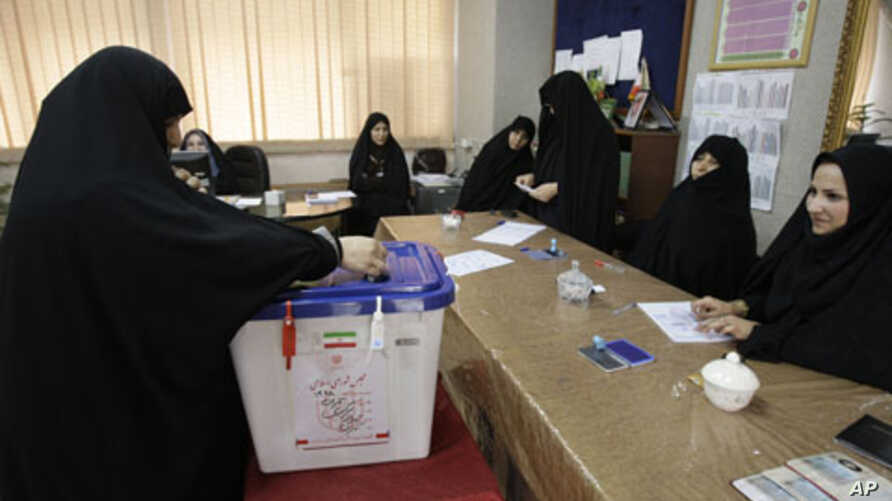 An Iranian woman casts her ballot for the parliamentary runoff elections, in a polling station, in Tehran, Iran, May 4, 2012.