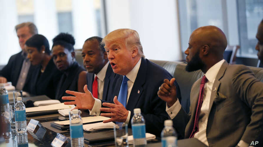 Republican presidential candidate Donald Trump holds a roundtable meeting with the Republican Leadership Initiative in his offices at Trump Tower in New York, Thursday, Aug. 25, 2016. Dr. Ben Carson is seated next to Trump at center.