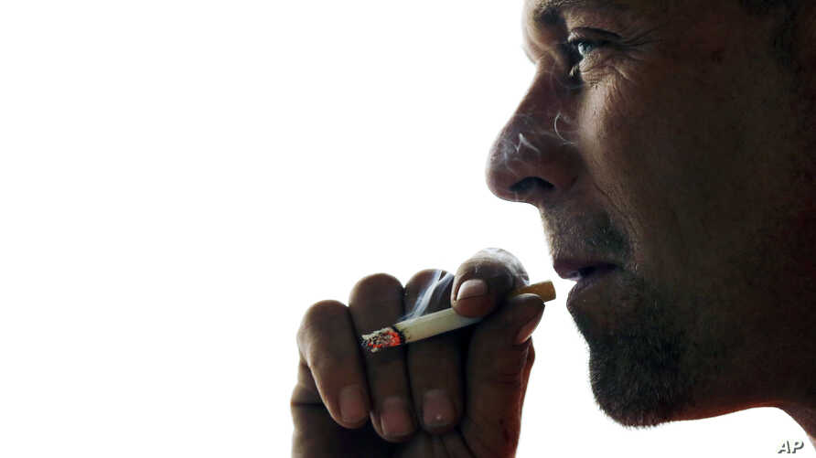 FILE - An analysis of research data finds that smokers, compared with people who had never smoked, were two times more likely to die of a number of diseases not usually thought to be related to cigarettes.