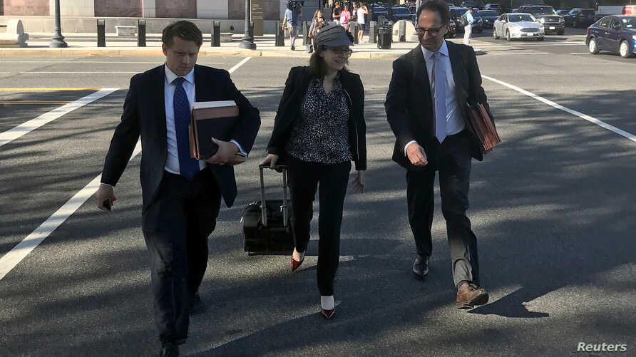 FILE - Kyle Freeny (C) and Andrew Weissmann (R), members of special counsel Robert Mueller's team of prosecutors investigating potential ties between Russia and U.S. Presidential Donald Trump's 2016 campaign, leave court in Washington D.C., U.S., Sep