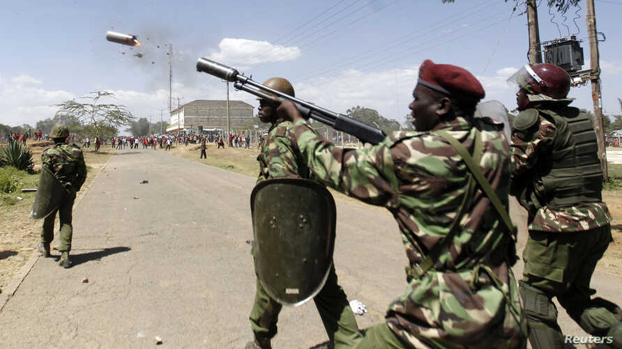 FILE - A riot policeman fires a teargas canister to disperse demonstrators during protests to oust Narok county Governor Samuel Tunai in Narok, Kenya, January 26, 2015.