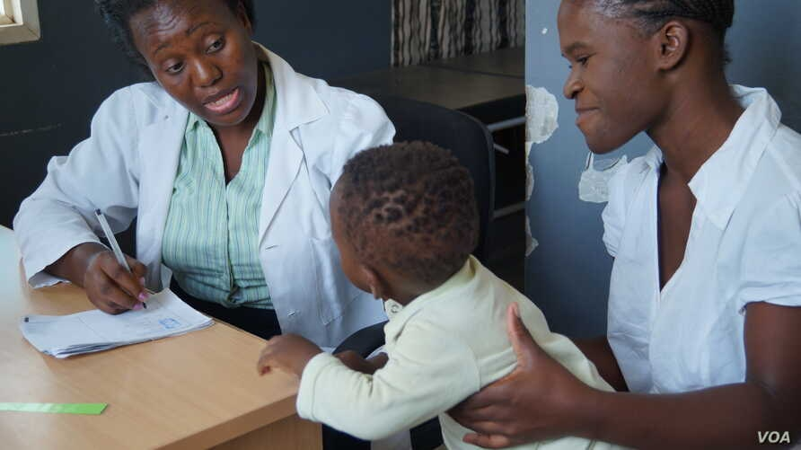 A medical worker attends to a child at Ndirande Health Center, one of eight health centers using the Chipatala Robot program in southern Malawi.