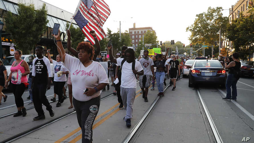 Demonstrators march in response to a not guilty verdict in the trial of former St. Louis police officer Jason Stockley in St. Louis, Sept. 16, 2017.
