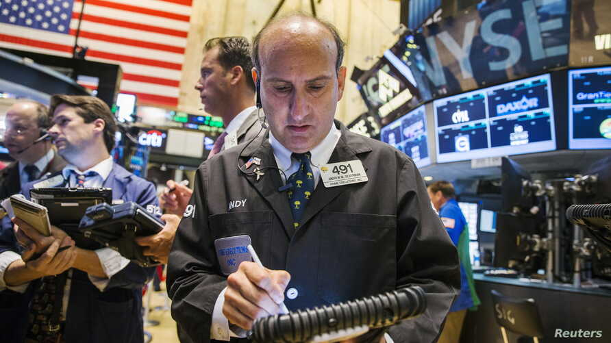 A trader works on the floor of the New York Stock Exchange shortly after the market opened in New York Sept. 1, 2015.