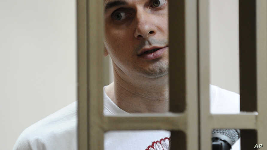 Oleh Sentsov stands behind glass in a cage at a courtroom in Rostov-on-Don, Russia, July  21, 2015.