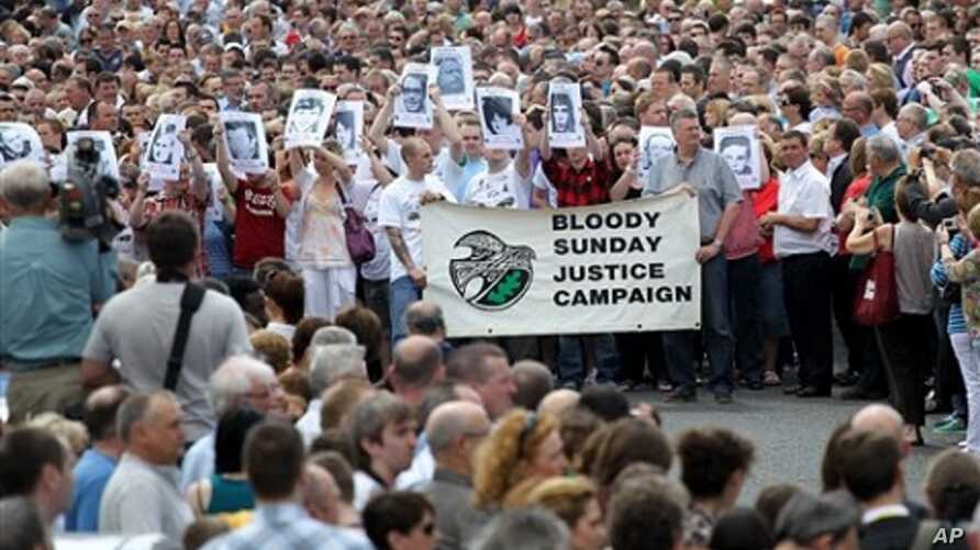 Relatives and families march to the Guildhall for a preview of the Saville report into the 1972 Bloody Sunday Shootings, in Londonderry, Northern Ireland, Tuesday, June, 15, 2010