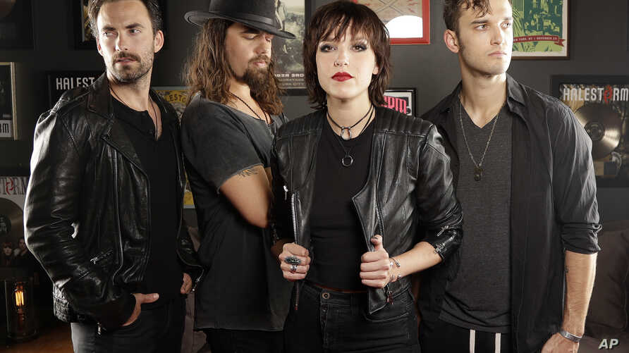"In this July 20, 2018, photo, members of Halestorm, from left, Josh Smith, Joe Hottinger, Lzzy Hale, and Arejay Hale pose in Nashville, Tenn., to promote their new record, ""Vicious,"" out on July 27."