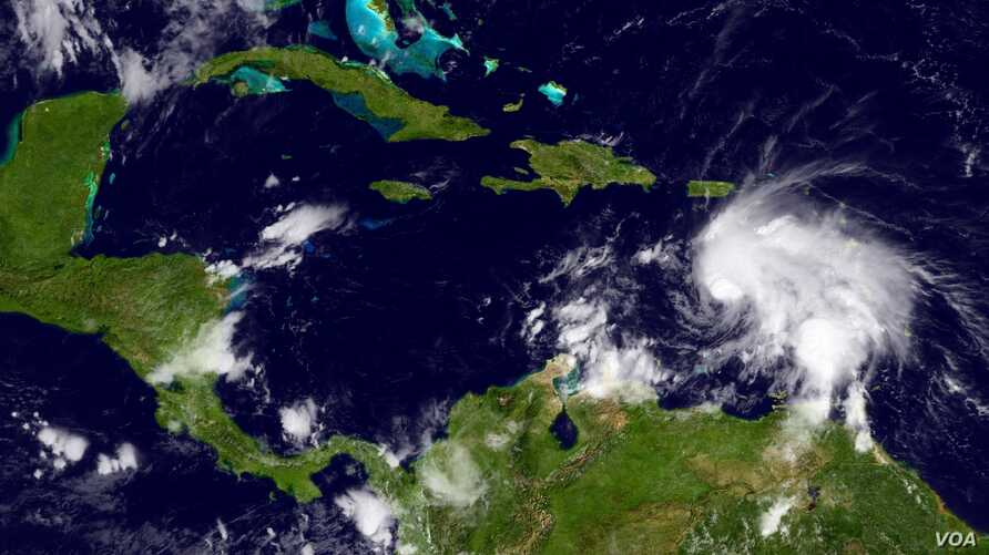 This GOES infrared and visible imagery shows storm activity in the Caribbean Sea region, Sept. 29, 2016.