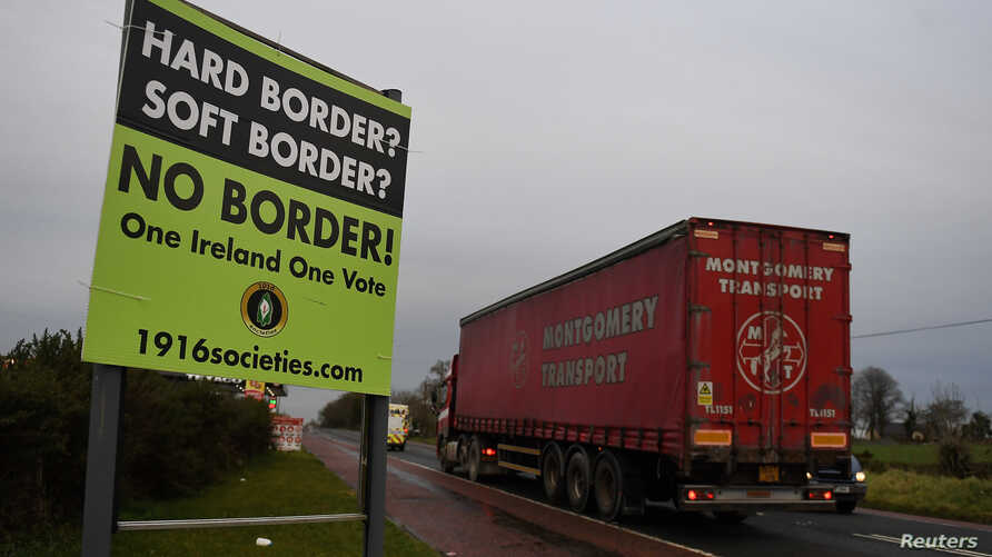"FILE - A sign for ""No border"" is seen on the border between Northern Ireland and Ireland in Jonesborough, Northern Ireland, Dec. 10, 2018."