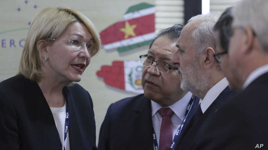 Venezuela's Chief Prosecutor Luisa Ortega Diaz, second left, talks with her counterparts during a meeting of Mercosur trade bloc prosecutors, in Brasilia, Brazil, Aug. 23, 2017. Brazil's attorney general is sharply criticizing the recent ouster of hi