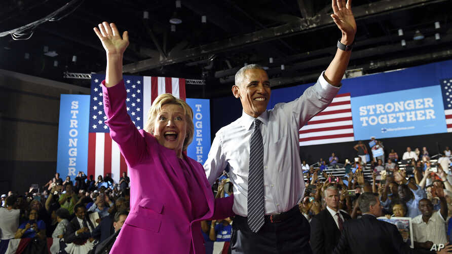 President Barack Obama and Democratic presidential candidate Hillary Clinton wave following a campaign event at the Charlotte Convention Center in Charlotte, North Carolina, July 5, 2016.