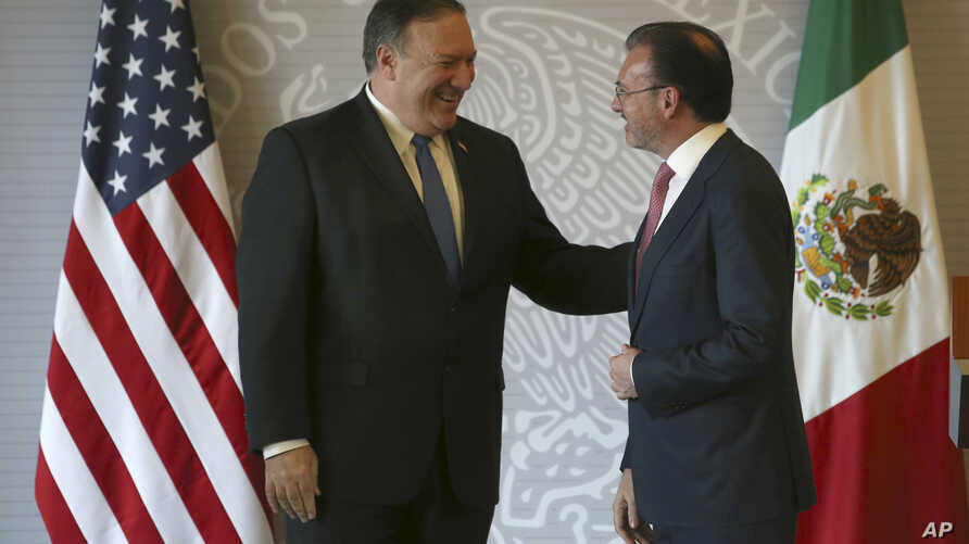 U.S. Secretary of State Mike Pompeo, left, and Mexican Foreign Minister Luis Videgaray smile after a press conference in Mexico City, July 13, 2018.