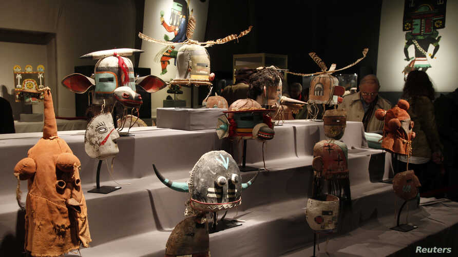 Antique tribal masks, revered as sacred ritual artifacts by a Native American tribe in Arizona, are displayed at an auction house in Paris, April 11, 2013.