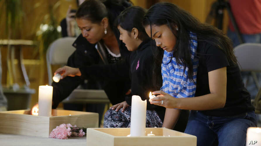 Guests light candles as they attend a prayer service, Sept. 24, 2016, at the Central United Methodist Church in Sedro-Woolley, Wash.